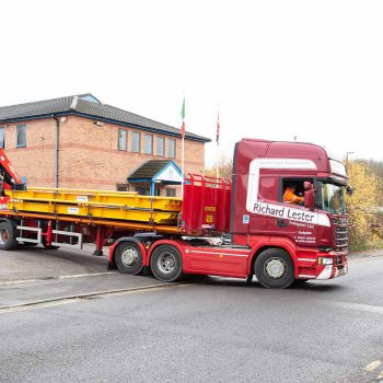 Weighbridge lorry driving out of warehouse