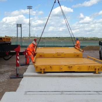 Weighbridge calibration systems being installed piece by piece