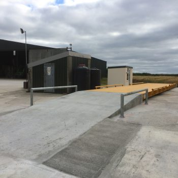 Surface mounted Eurodeck weighbridge installed with concrete ramp