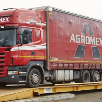 large surface mounted Eurodeck weighbridge in use with truck