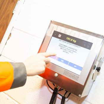 Itemised Waste Management user touching screen