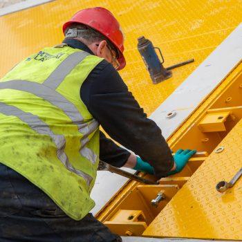 engineer repairing weighbridge